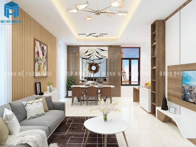 Phòng khách liền bếp được thiết kế với nội thất tối giản, gam màu tươi sáng