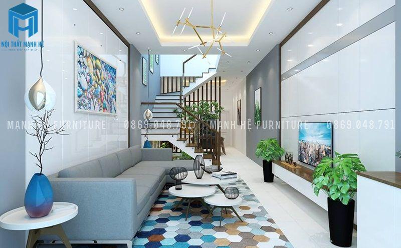Phòng khách với nội thất đơn giản gồm bộ ghế sofa, bàn trà và kệ ti vi bố trí hợp lý, phối màu hài hòa