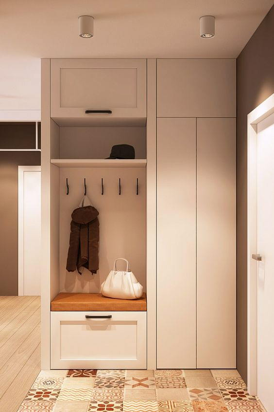 Tủ quần áo một buồng chứa, bên còn lại làm kệ đựng đồ tùy theo nhu càu chủ gia. Chiếc tủ được thiết kế nhỏ gọn, dễ thương