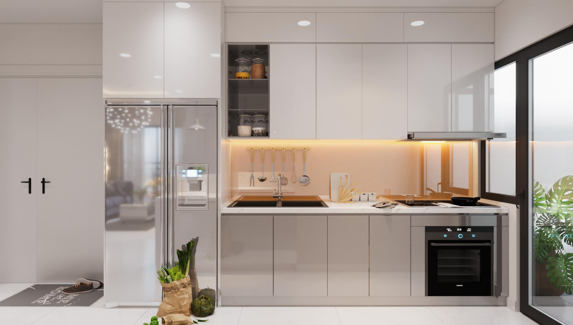Vì không gian phòng bếp nhỏ hạn chế, chủ gia tận dụng tối đa chiều cao để thiết kế tủ bếp đụng tường, chiều dài cũng khít với cửa hông